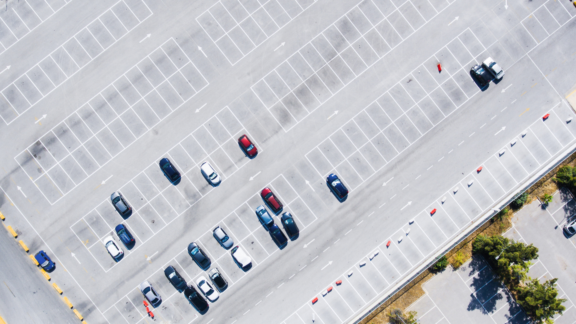 An aerial picture of an empty parking lot, surprising facts about parking you probably didn't know, Spot Parking