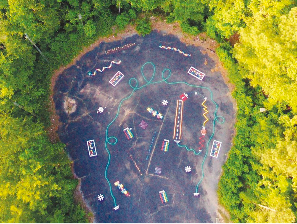 An aerial view of a kid's play zone, parking lots reinvented
