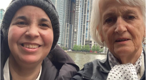 VIPand Volunteer taking  a selfie while taking a walk along the river Thames in Canary Wharf