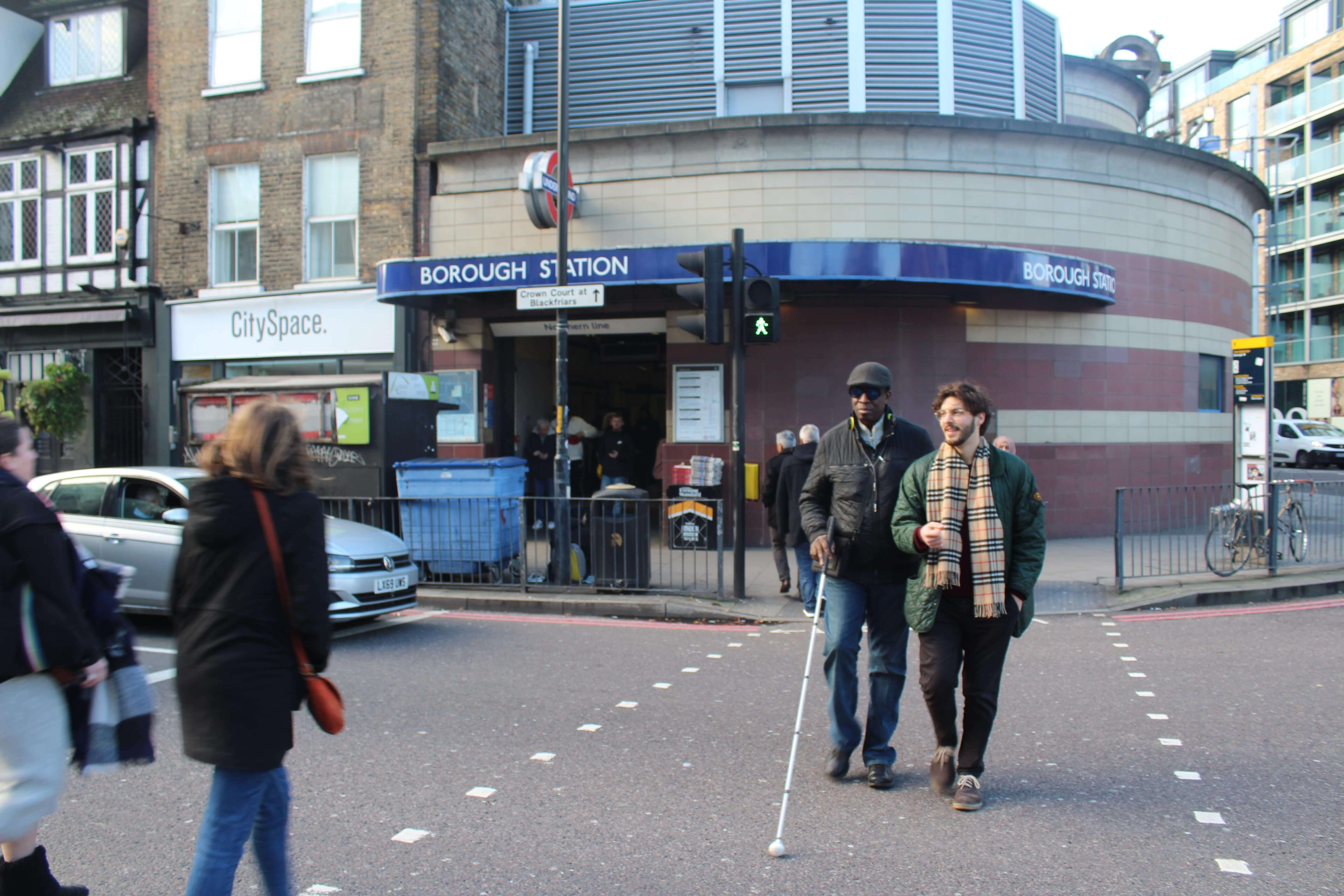 Tube station - the first step of travel visually impaired person with volunteer