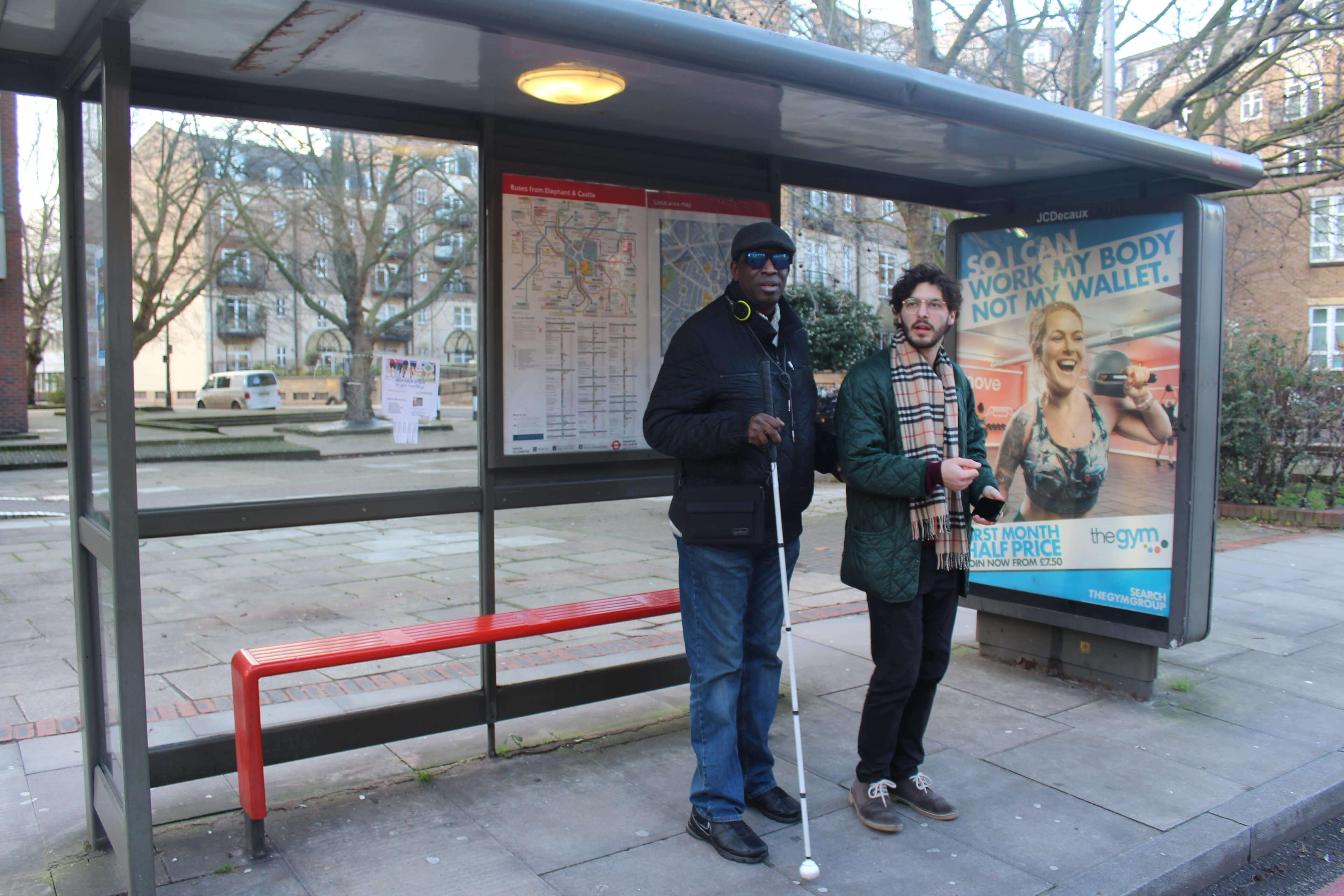 Bus stop - the last step of travel visually impaired person with volunteer