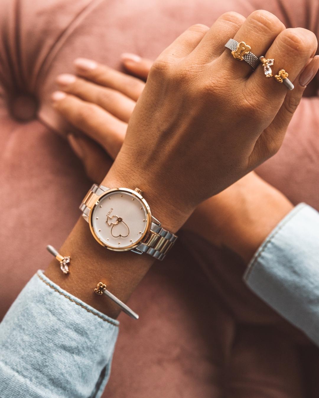 watch design Tous watch worn on wrist with a gold bracelet
