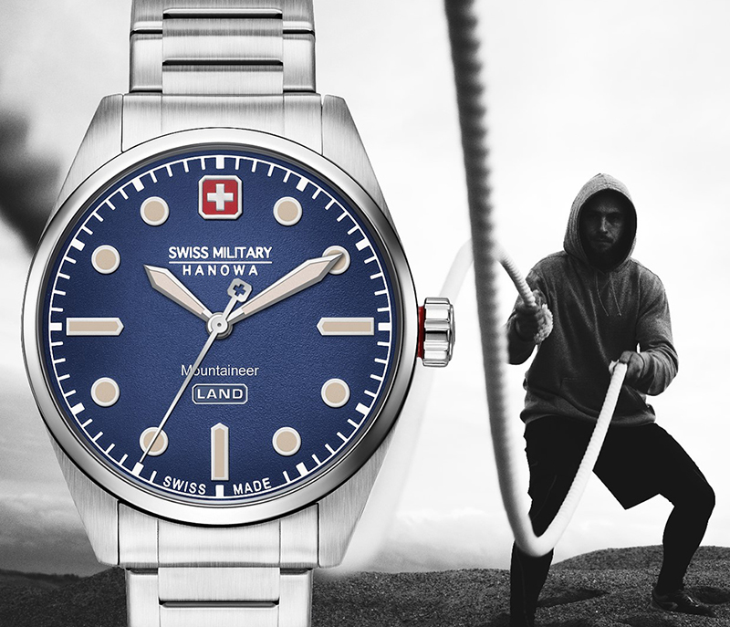 Steel aventurer style watch with a blue dial