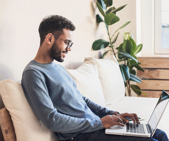 men using laptop sitting in a couch