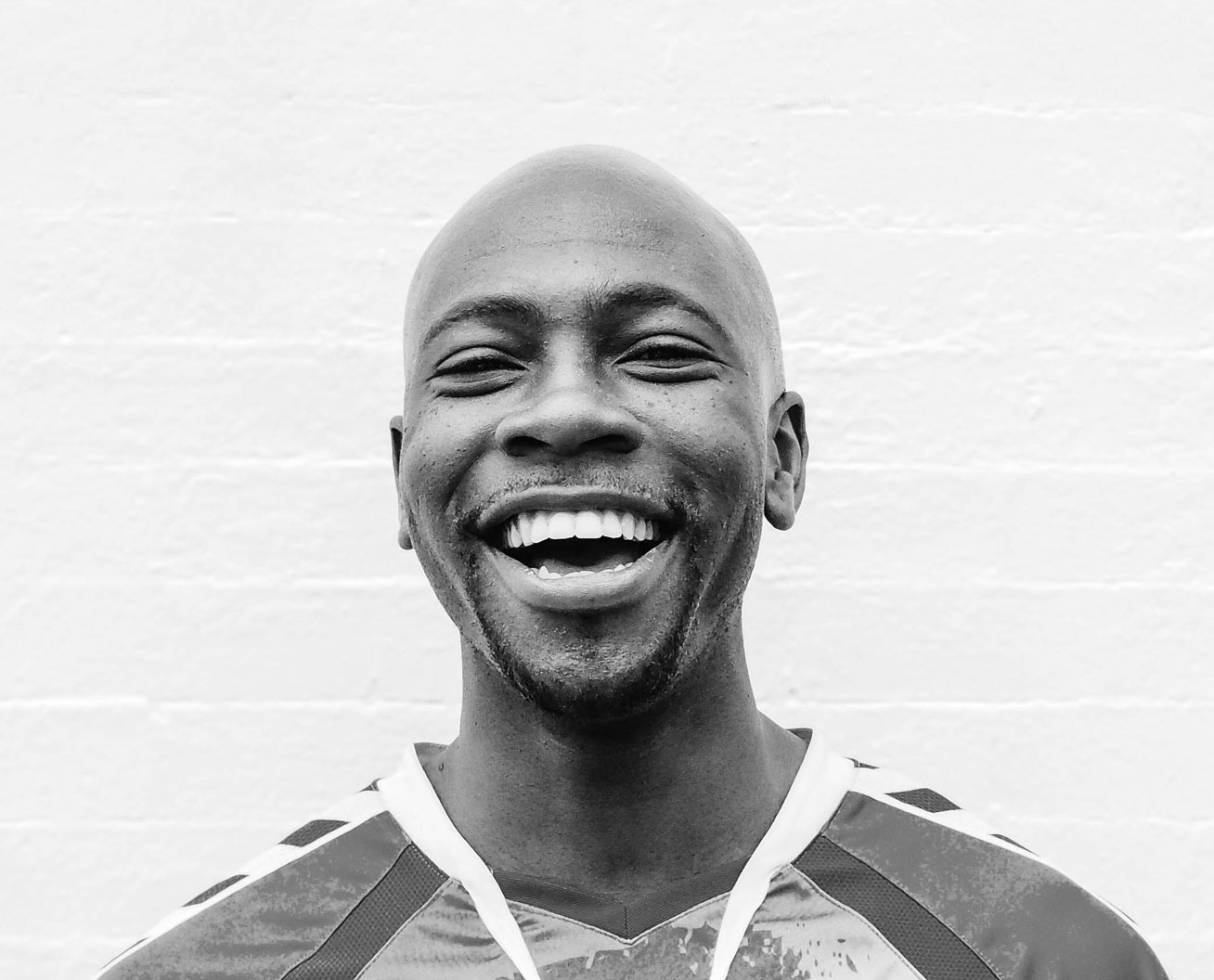 Portrait shot of a bald man smiling at camera