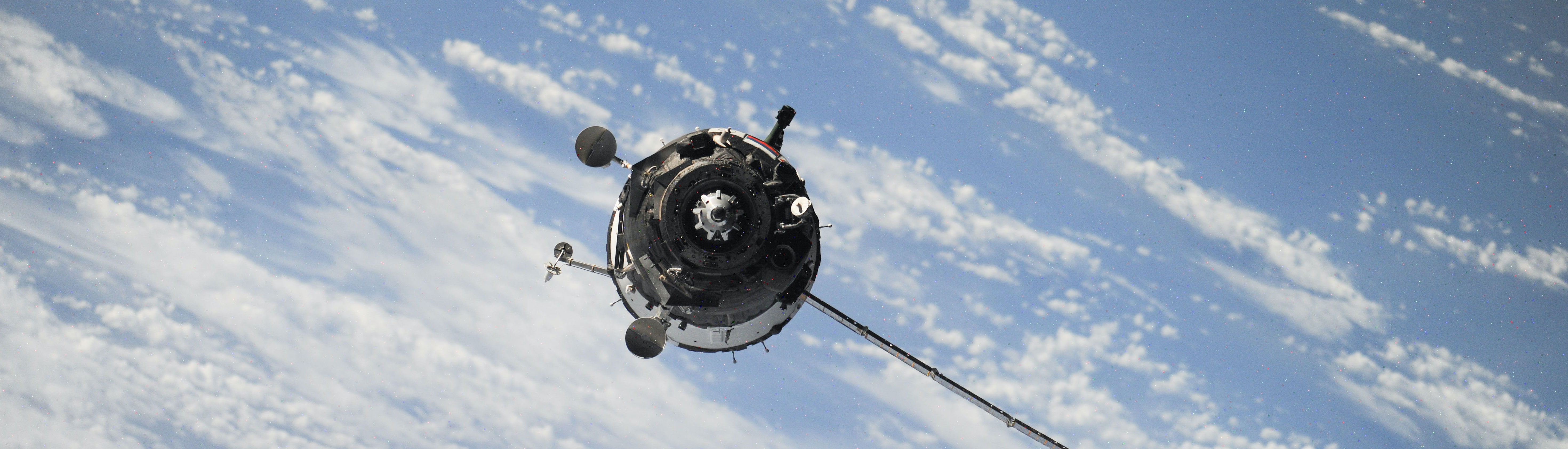 Satellite in space hovering over earth