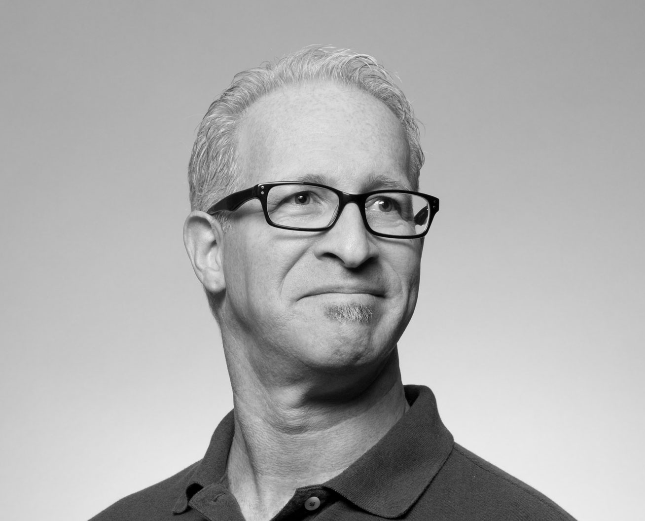 Portrait shot of a middle-aged man wearing spectacles