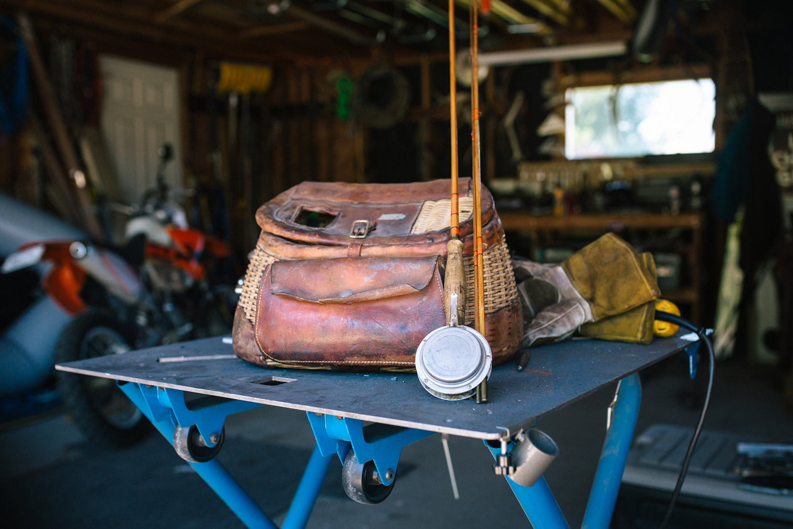 Mike Gurnett poses for this Montana photography session while he shows his grandfather's fishing bag and reel in Helena, Montana.