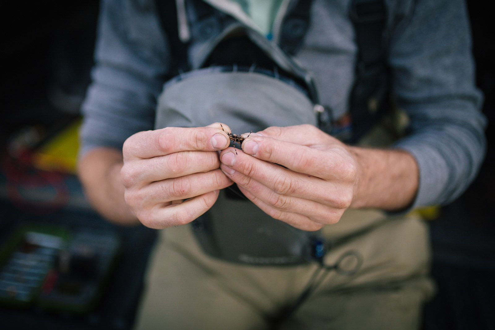 Patrick Burr ties a fishing fly in this Montana photography session.