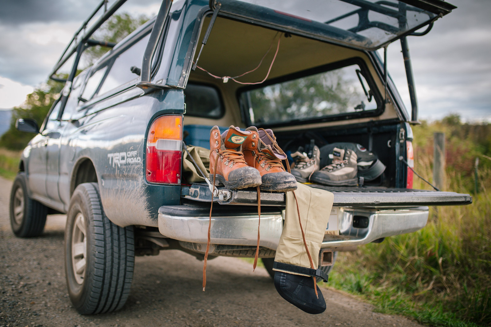 Patrick Burr prepares his fishing boots in this Montana photography session.