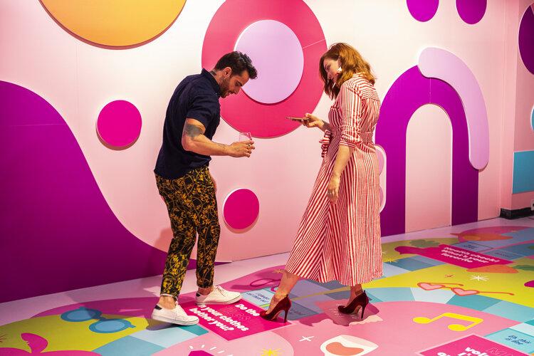 rose mansion-pop-up-design-people in game room