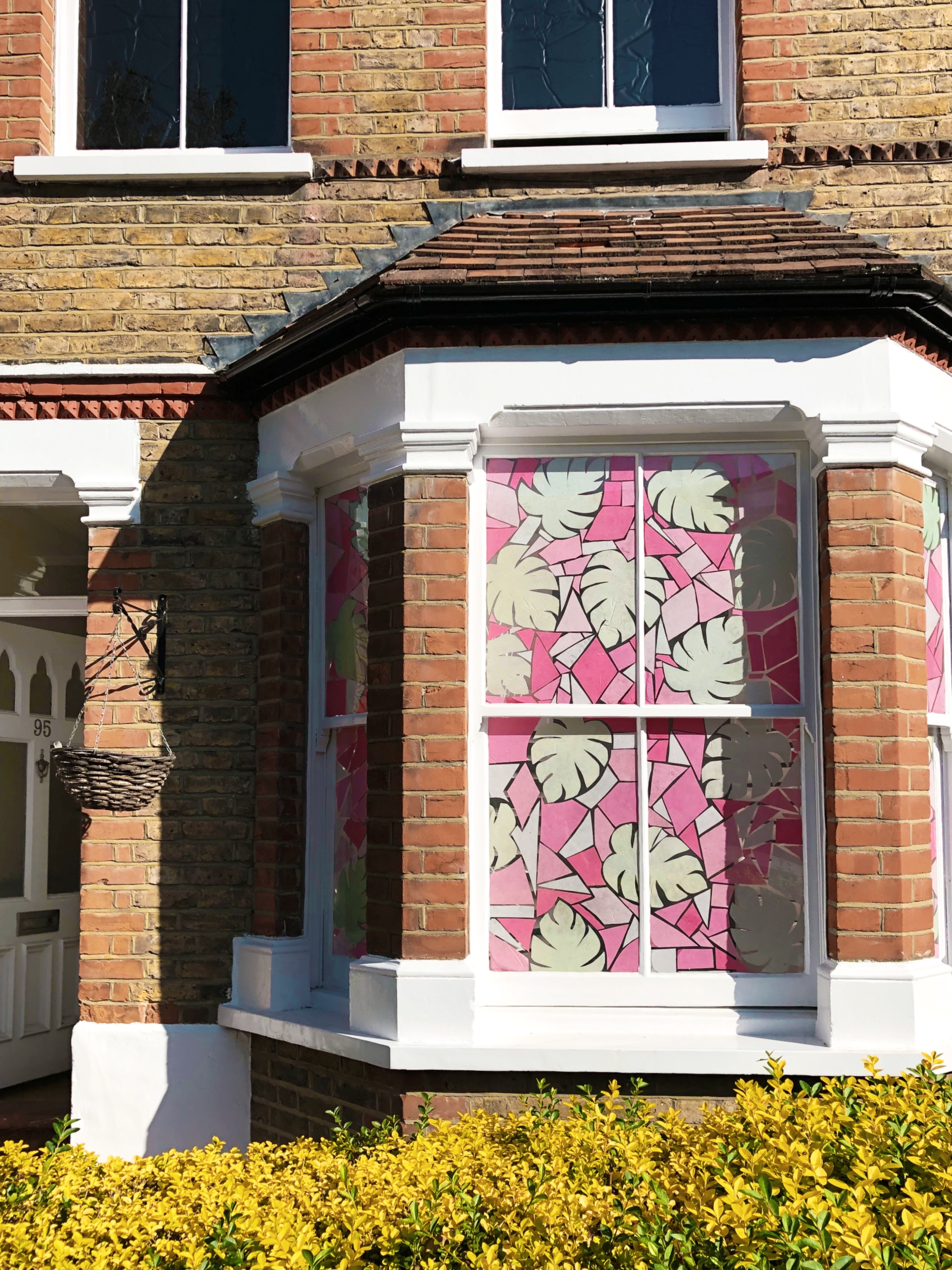 tropical stained glass window art installation