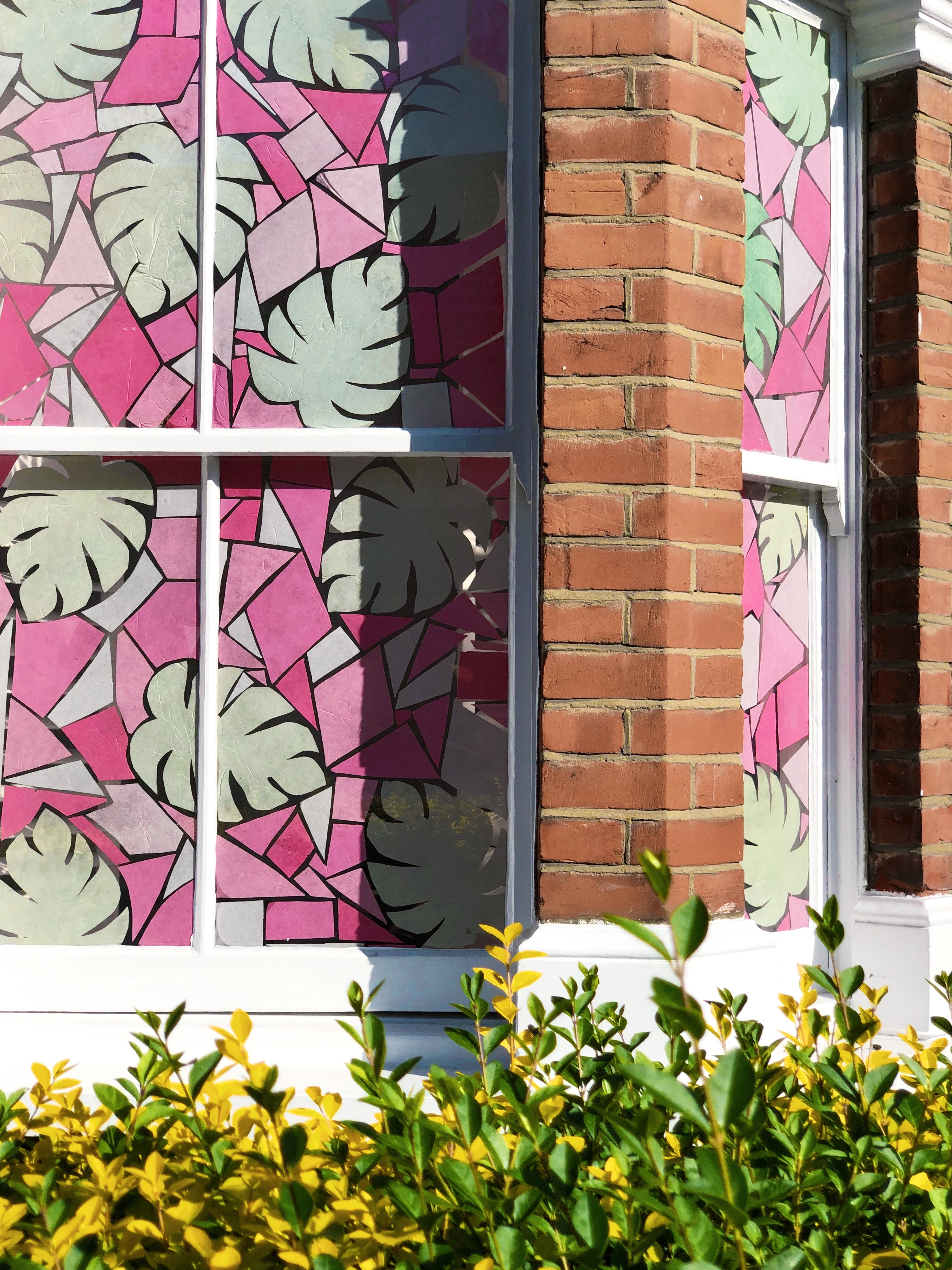 tropical stained glass window art installation pink
