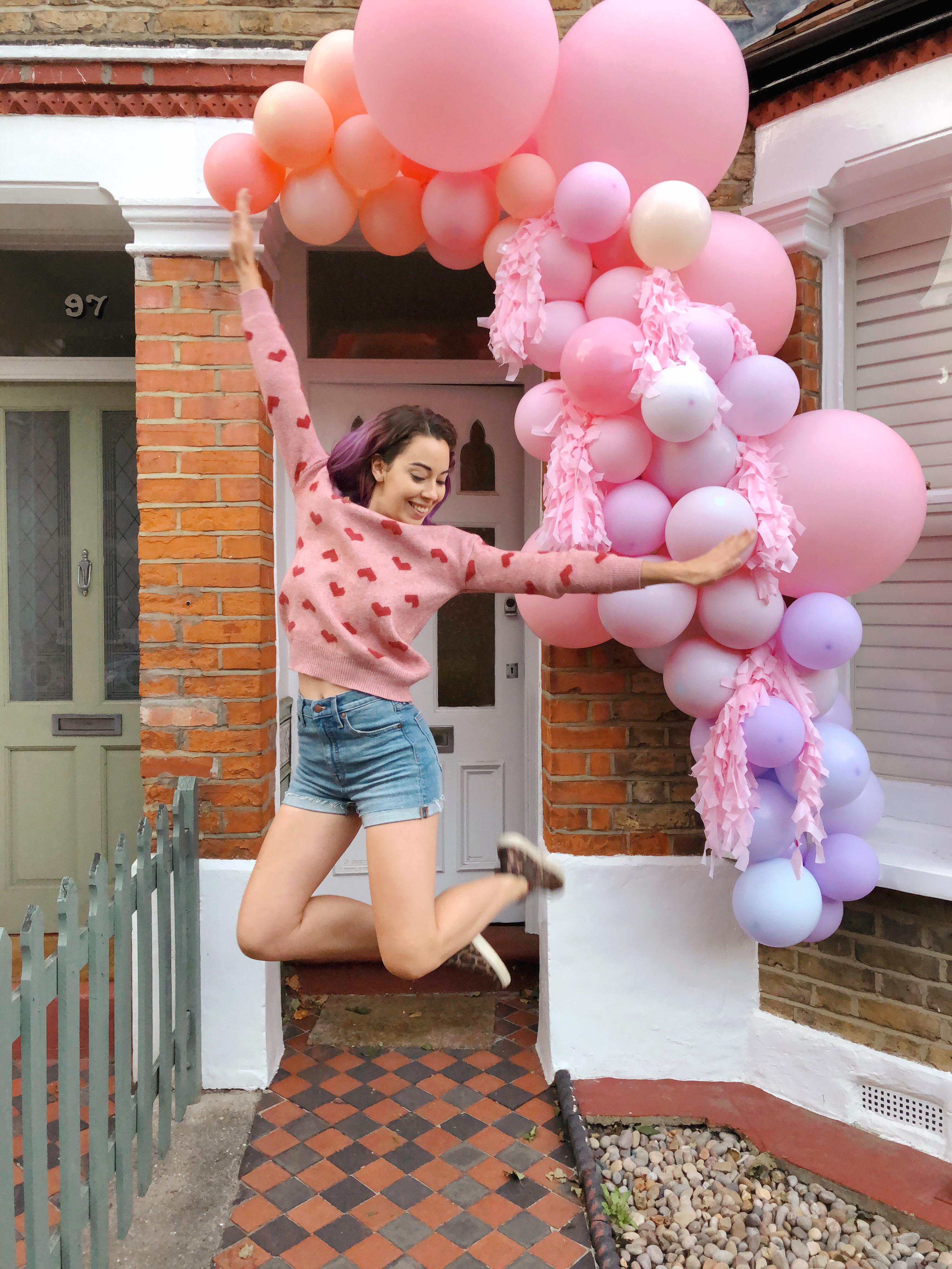 Balloon garland with Kelly jumping - art installation
