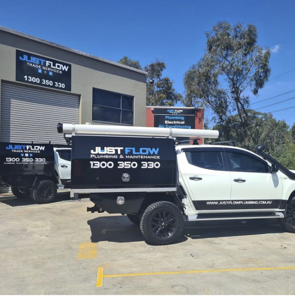 two justflow plumbing utes in front of the justflow office located in Moorebank
