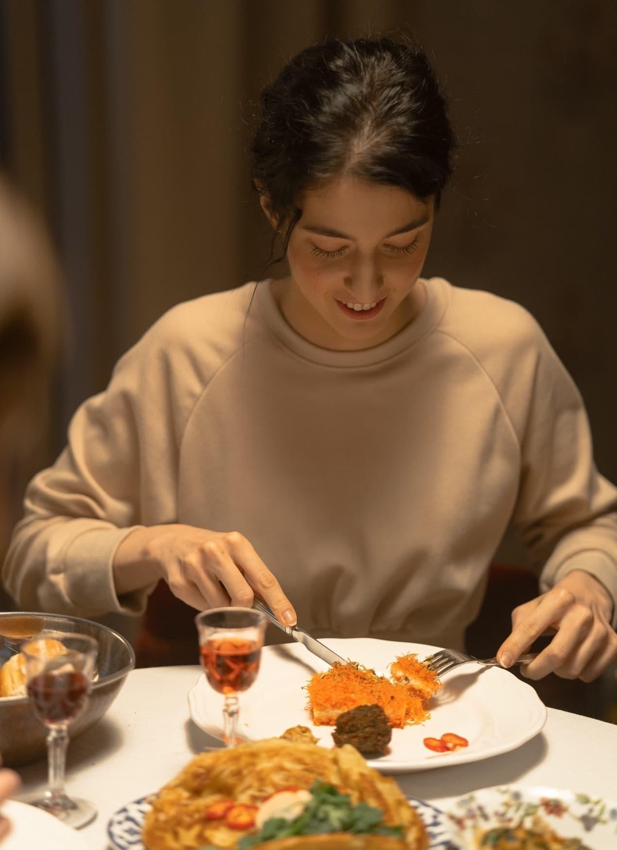Toyama Controls - woman busy  eating