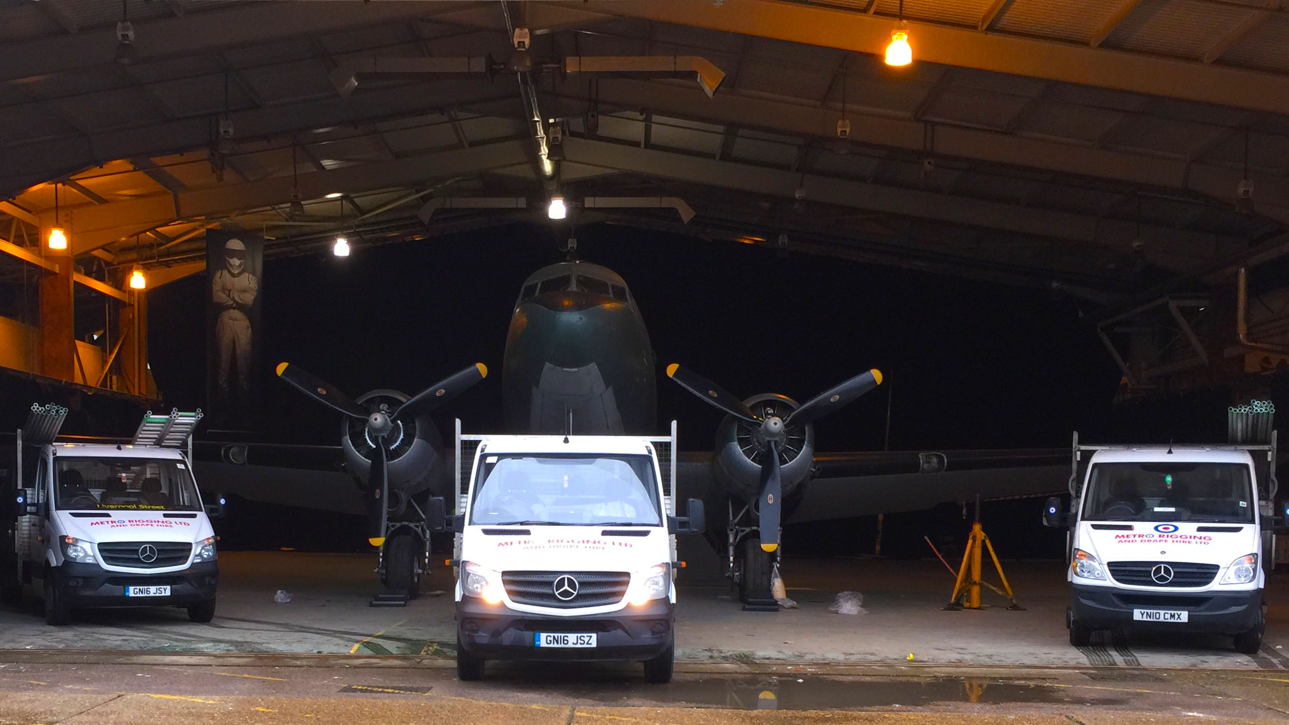 Our transportation vans in a hangar, ready to tow a jet plane to film.