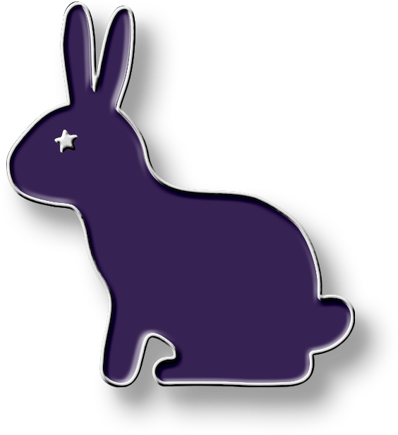 An enamel pin in the shape of a purple rabbit with a star for an eye