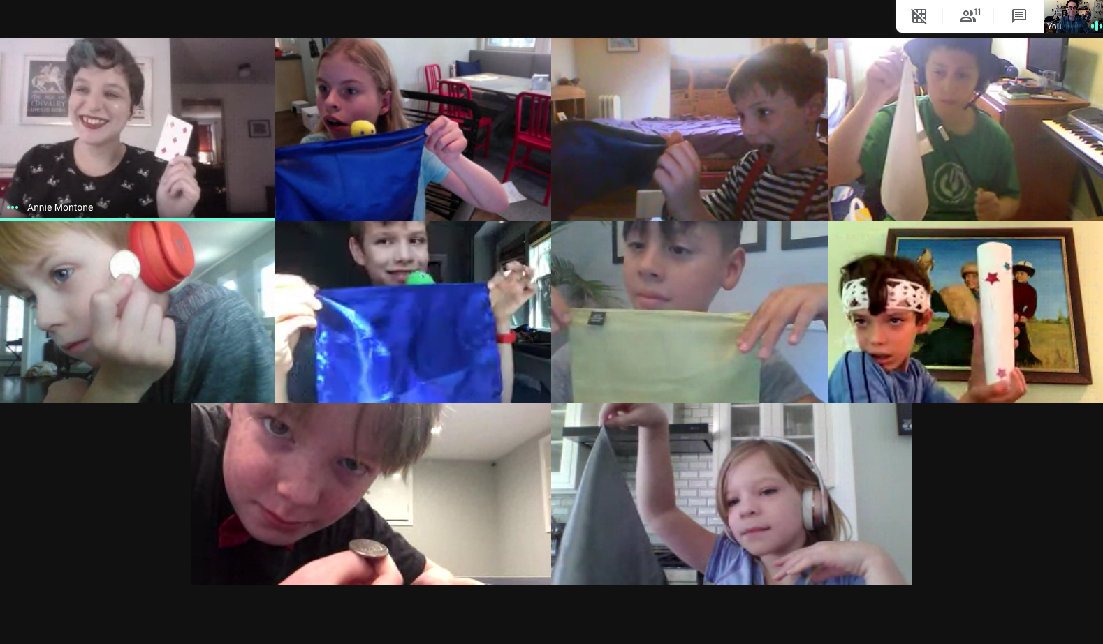A grid of students taking virtual summer camp. They are all posing with their favorite props.