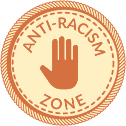 """An orange circular badge with a hand in the middle and words that say """"Anti-racism Zone"""""""