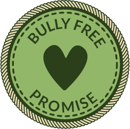 """A green circular badge with a heart in the middle and words that say """"Bully Free Promise"""""""