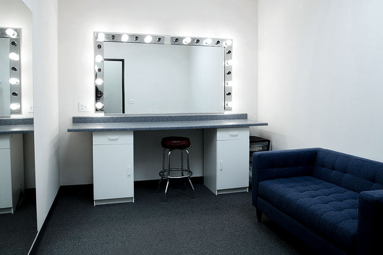 Moonbeam Studios' green room where models prepare for a production with make-up and hair as well as wardrobe .