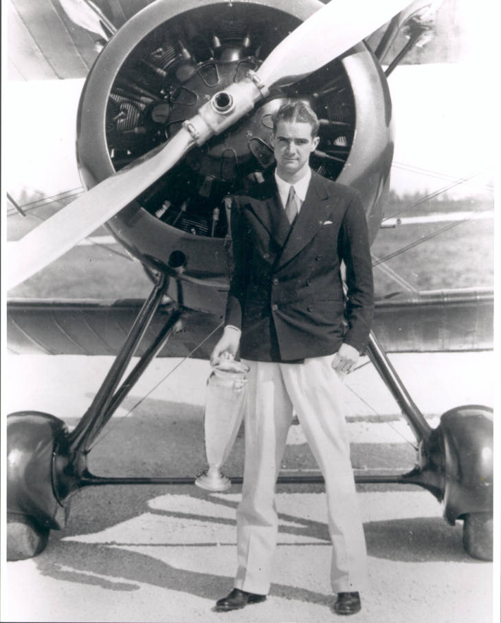 Howard Hughes in front of his biplane in 1934
