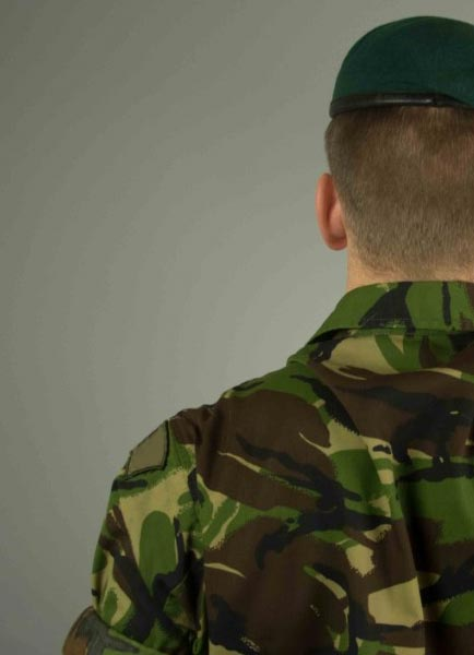 The back of a military man standing