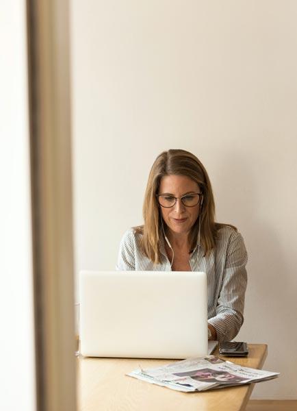 Smart woman working on laptop