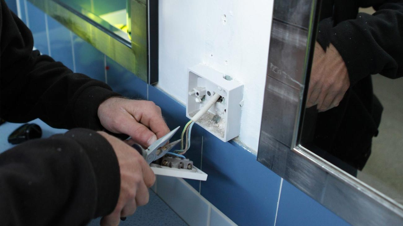 Electrical maintenance fixing a plug