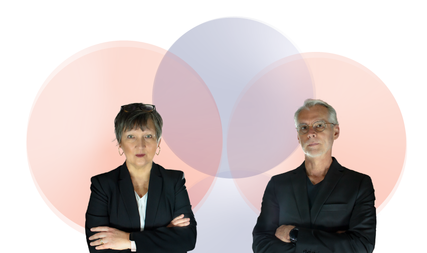 Susan and Kris VanHemert standing in front of butterfly symbol