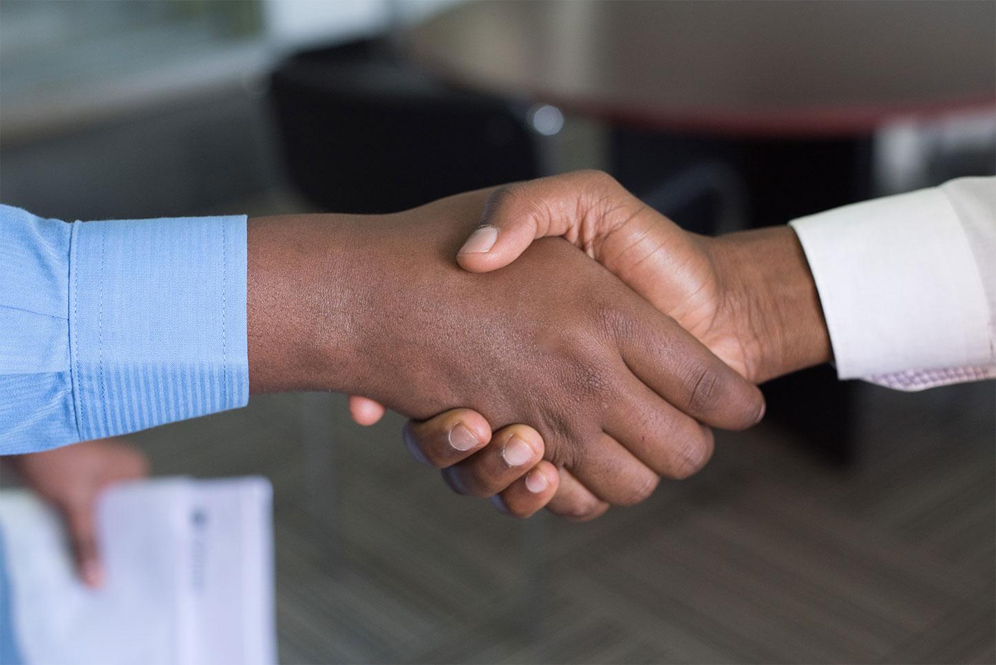 Handshake between two people.