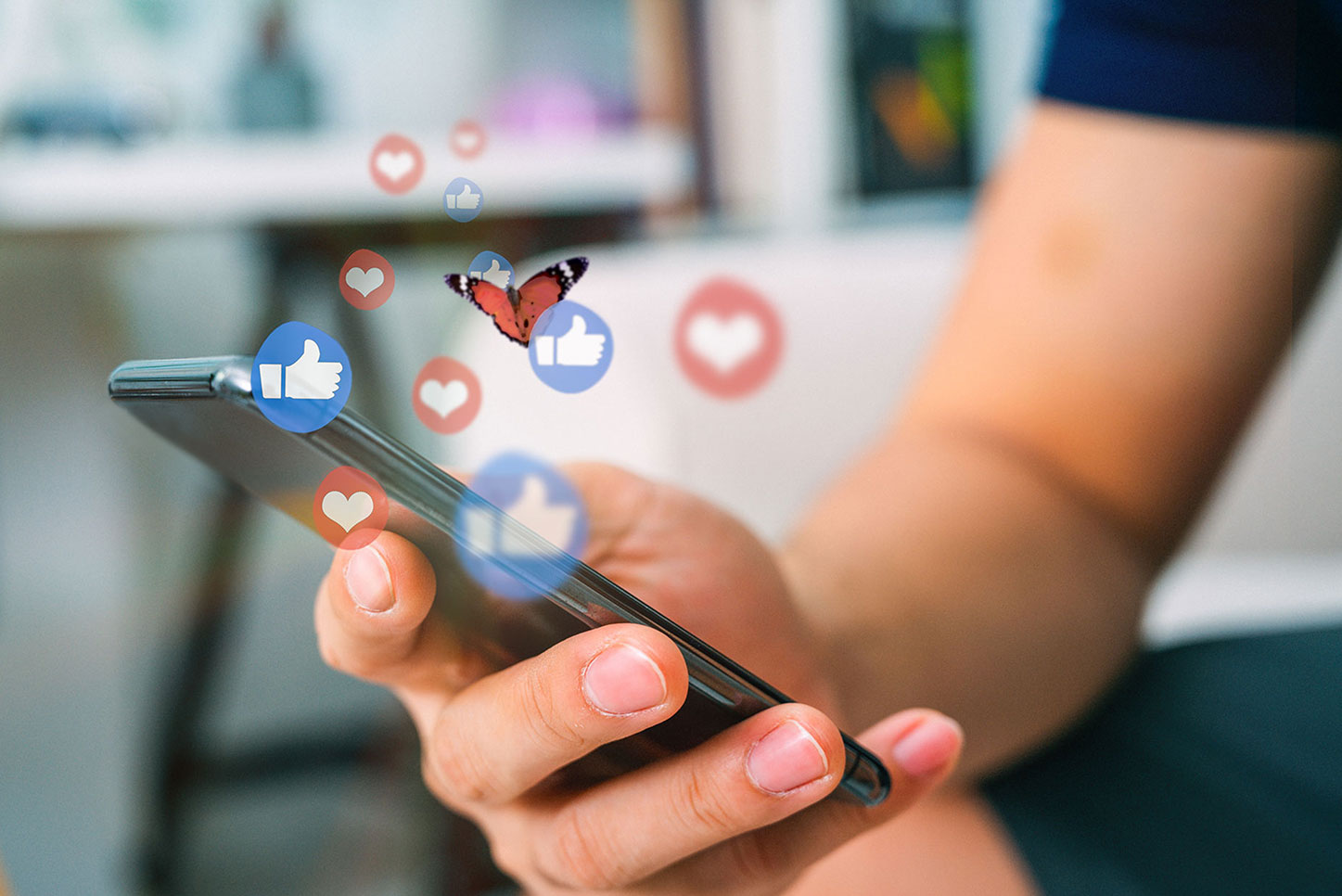 Person using smartphone for social media. Butterfly floating above.