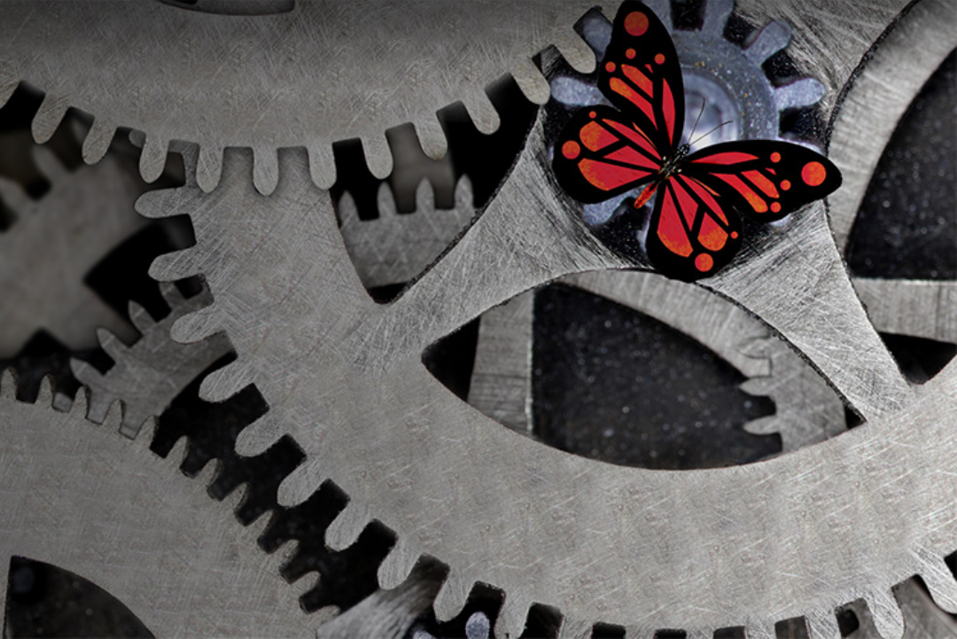 A butterfly resting on cogs.