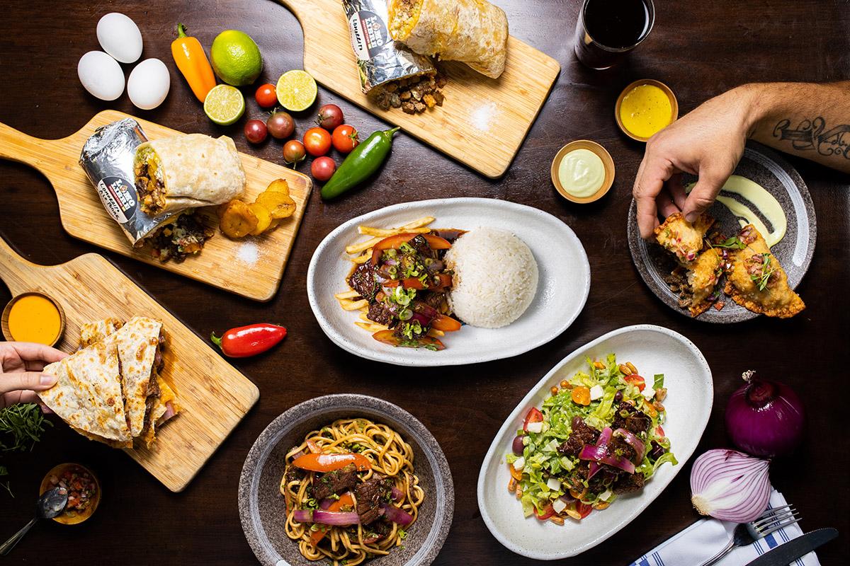 An array of delicious food! Quesadilla, Lomo Saltado, Lomo Noodles, Lomo Toro Salad, and Lomo Empanadas.