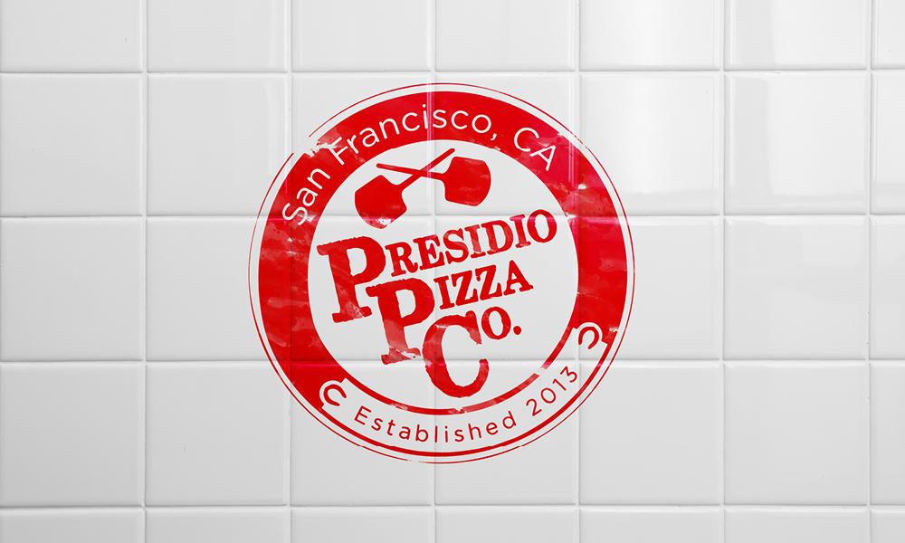 Red presidio pizza logo on a white tile background.