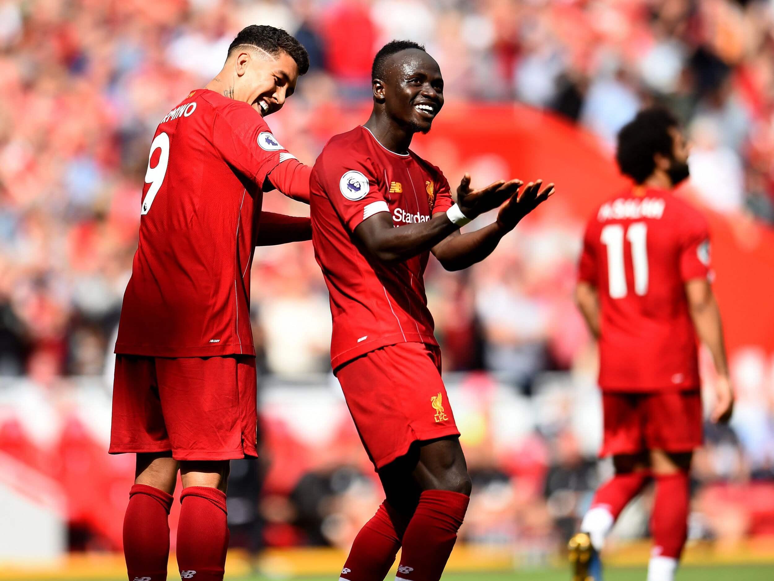 Sadio Mane celebrates with Roberto Firmino at Anfield