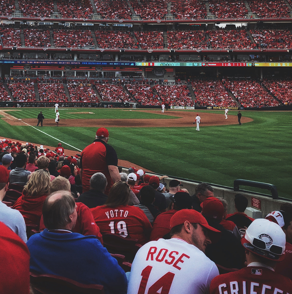 A baseball fans watching the game in a stadium