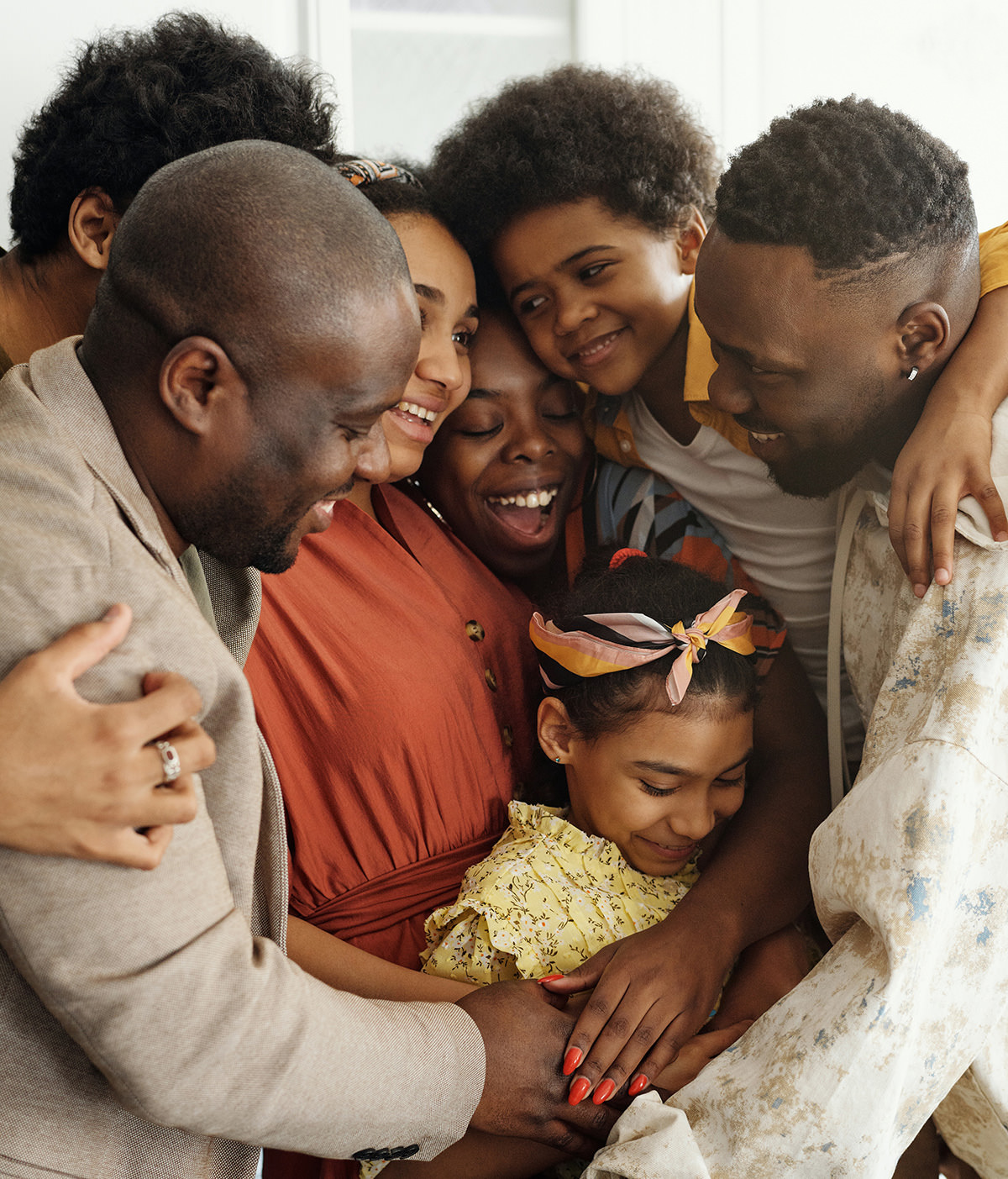 A afro american family hugging each other