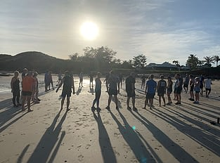 People on Cable beach doing bootcamp