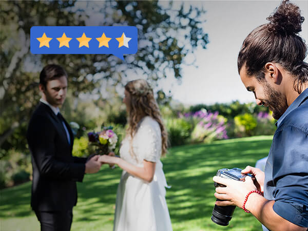 Man holding camera looking at review received from buyers near by