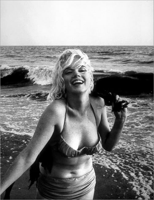 Marilyn Monroe at beach in swimsuit, 1962