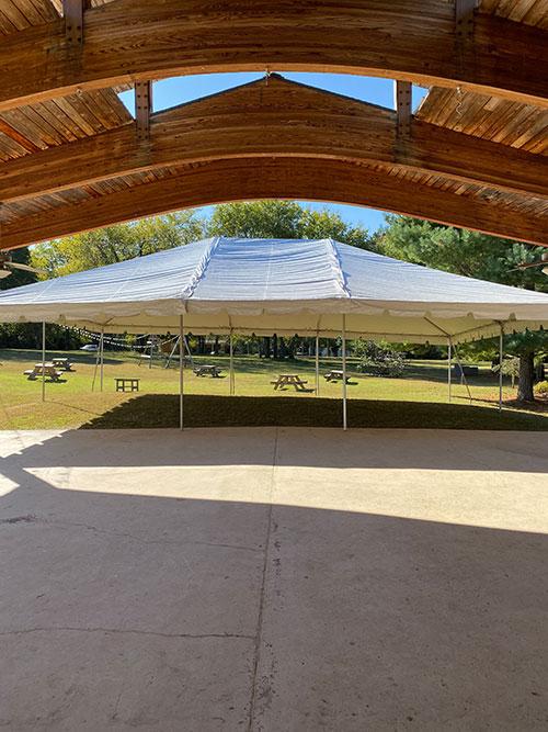 Rock castle pavilion with tent