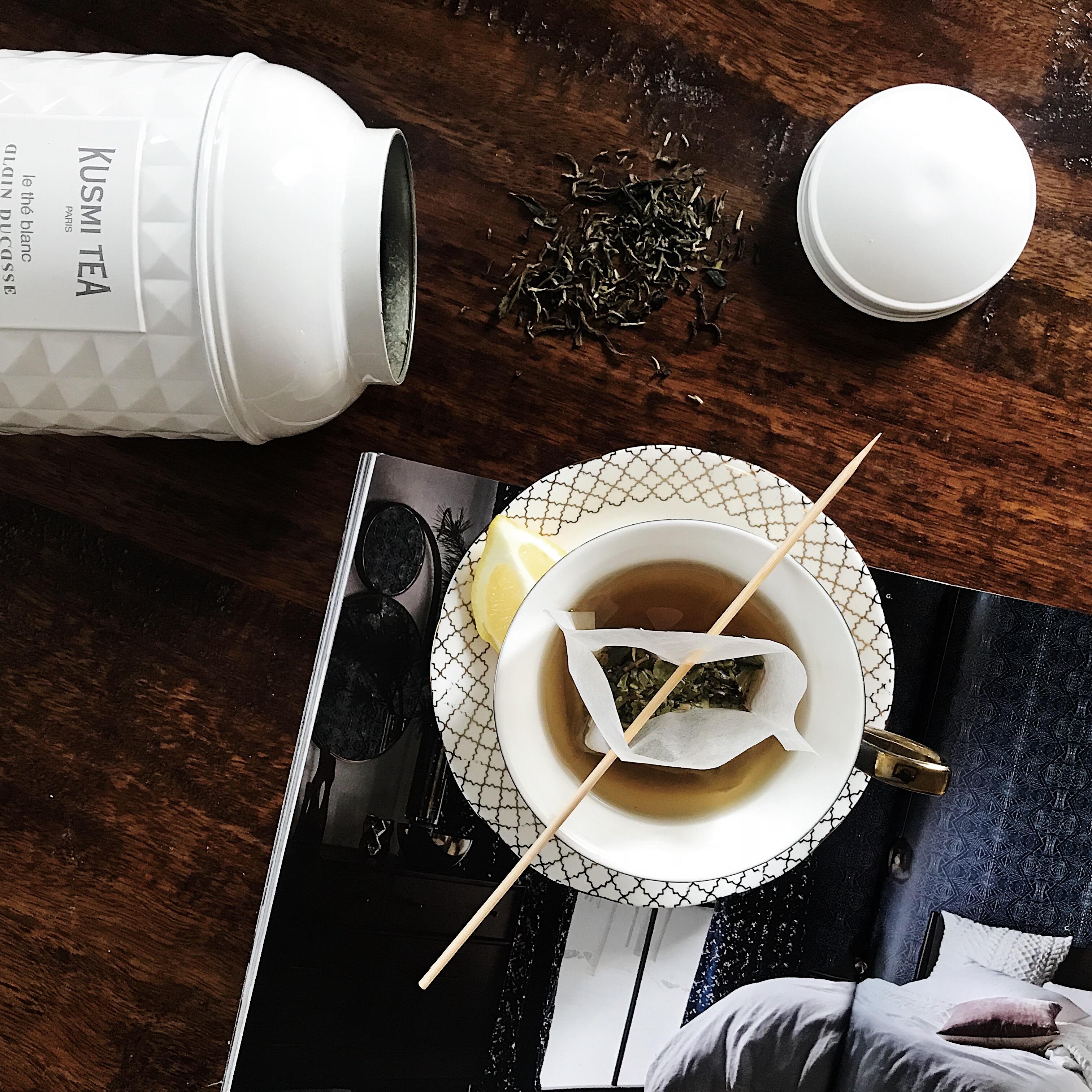 Freshly brewed Kusmi black Tea Sitting on a magazine.