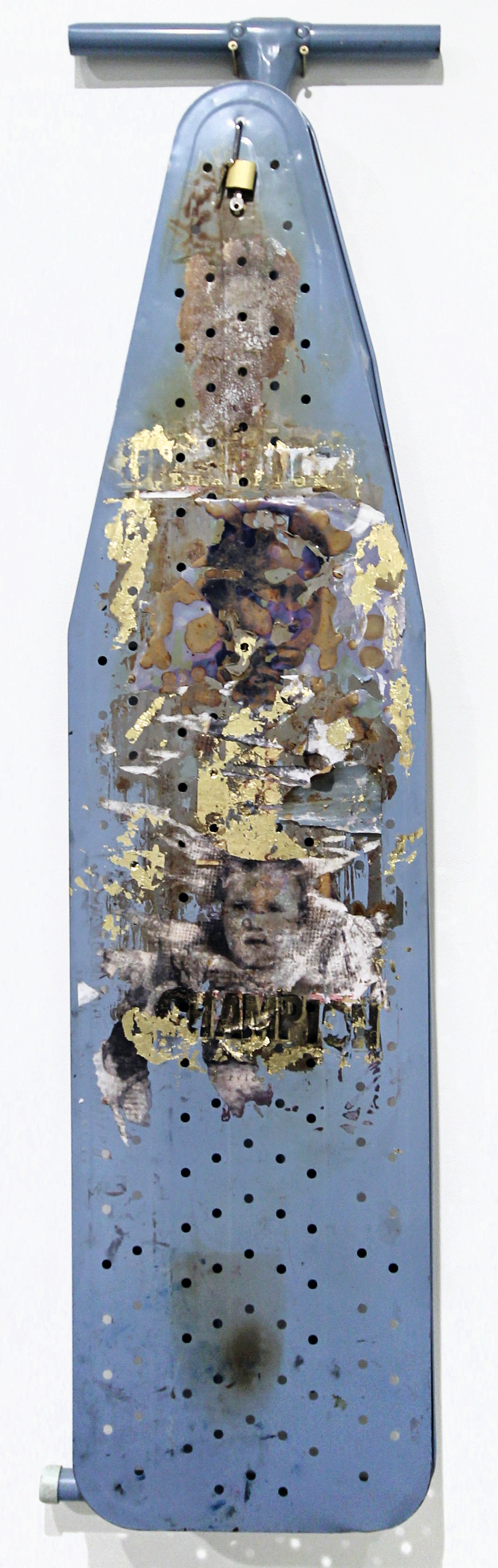 transfer print on ironing board, gold leaf, embossing; found objects