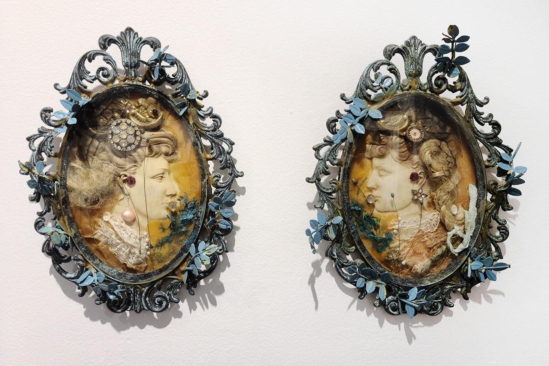 doll hair, beeswax, print on transparency, cut metal leaves, door handles, antique brooch, rabbit fur