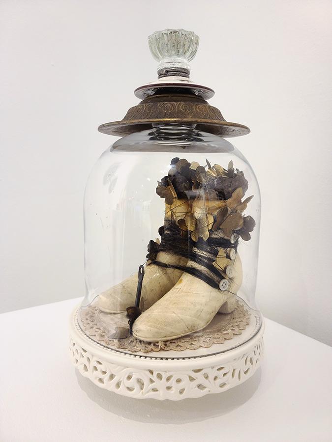 horse hair, brass butterflies, antique buttons, ceramic boots, bell jar, beeswax