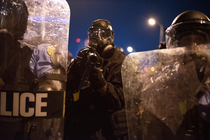 Police and protesters clash on the Crescent City Connection on June 3, 2020. Police used less than lethal munitions and teargas to disperse thousands of peaceful protesters leading to widespread condemnation. The officers repeatedly threatened to shoot me while taking these photos.