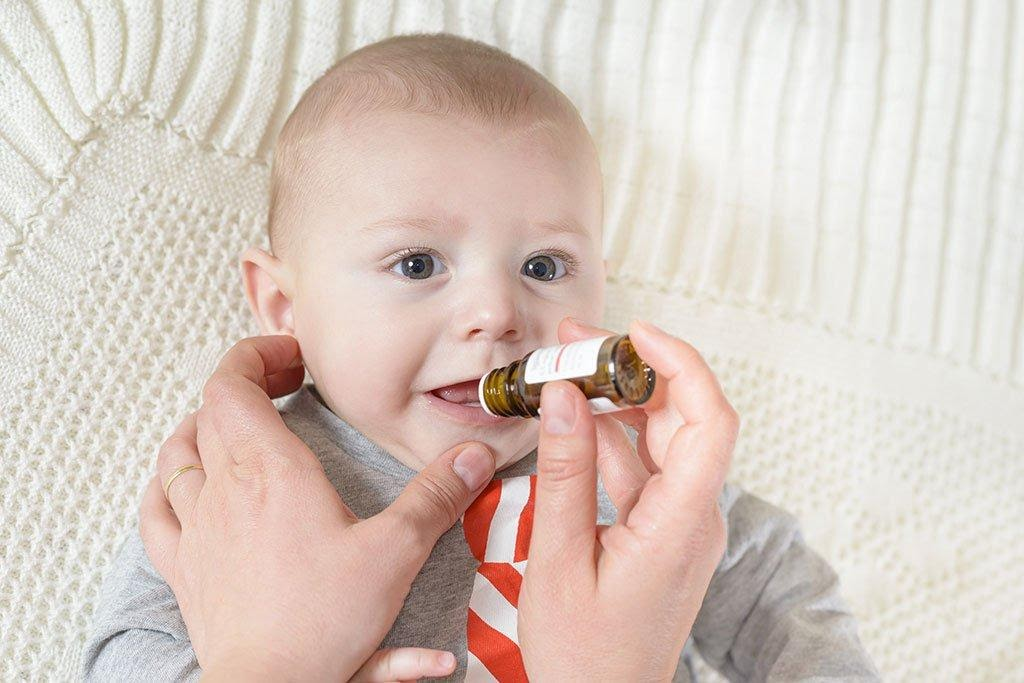 A baby with a pacifier in its mouthDescription automatically generated with low confidence