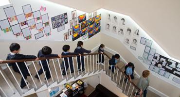 Kids walking down the stairs in St Johns Wood Prep School